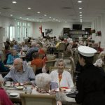 Residents enjoy their Canada Day barbecued meal in the Dining Room
