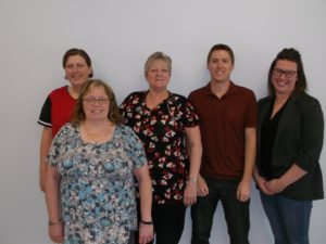 A group photo (including 4 females and 1 male) stand for a photo. These people are a part of the My Health Team Brandon at Meredith Medical