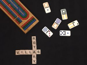Crib board, dominoes, and Scrabble pieces spell out Rotary Villas