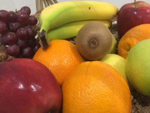 Grapes, apples, oranges, kiwi, and bananas