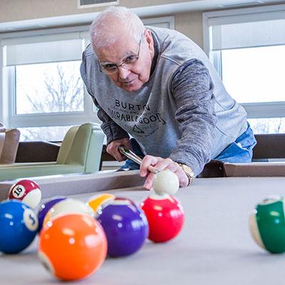 Playing billiards at Rotary Villas